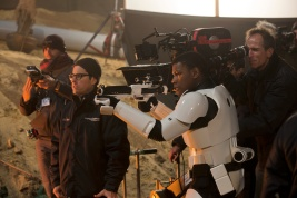 Star Wars: The Force Awakens L to R: Director J.J. Abrams on set w/ John Boyega (Finn). Ph: David James ©Lucasfilm 2015