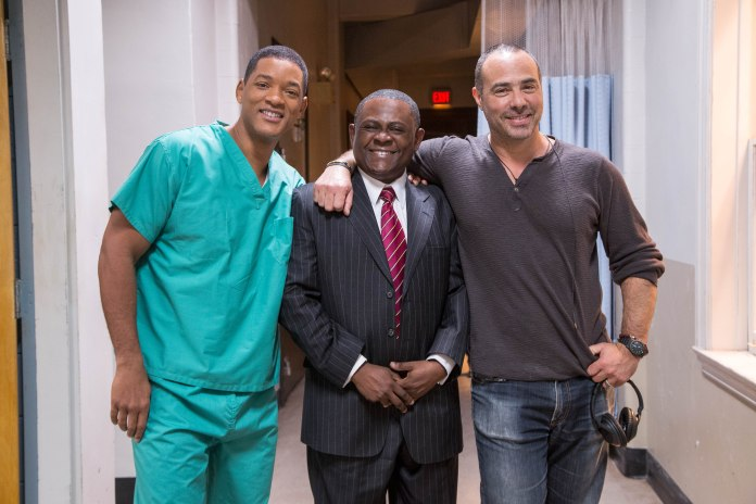 """L-r, Will Smith, the real Bennet Omalu, and director Peter Landesman on the set of Columbia Pictures' """"Concussion."""""""